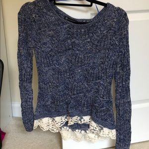 Blue sweater with white frills